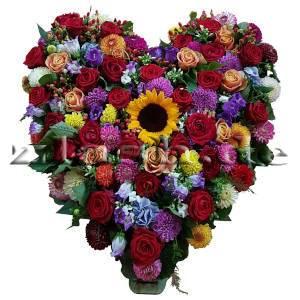 Buntes Blumenherz mit Sonnenblume